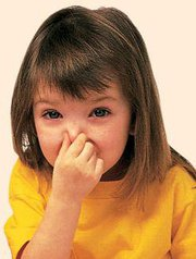 Girl holding her nose shut with her fingers